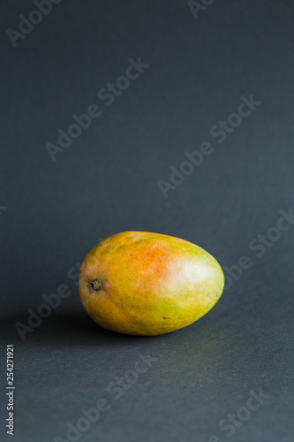 Mango. Tropical Fruits. On a black background. Copy space. - 254271921