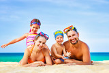 happy family father, mother and children on  beach at sea