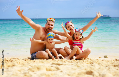 happy family father, mother and children on  beach at sea - 254276930