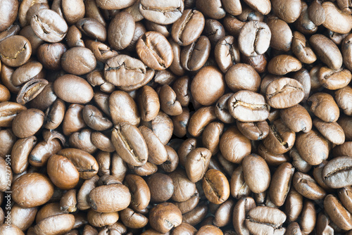 Brown coffee beans texture or background with high resolution detail