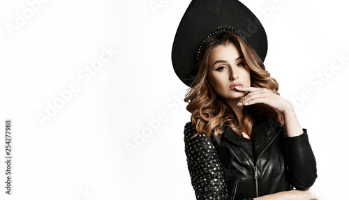 Beauty woman in new modern fashion leather jacket and Russian style kokoshnik hat on white