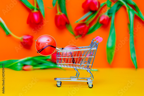 sunglasses in shopping cart and tulips