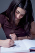 Beautiful female art designer draws a pencil sketch