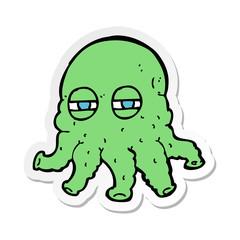 sticker of a cartoon alien face