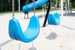 Empty Swings on the Children's Playground