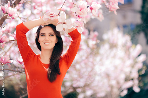 Happy Woman Enjoying Spring Sun Under a Magnolia Tree