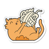 sticker of a cartoon cat playing with ball of string