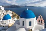Blue and white domed churches on Santorini Greek Island, Oia town, Santorini, Greece.