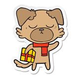 sticker of a cute cartoon dog with christmas present