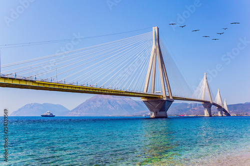 White cable-stayed bridge over the Gulf of Corinth - 254339569