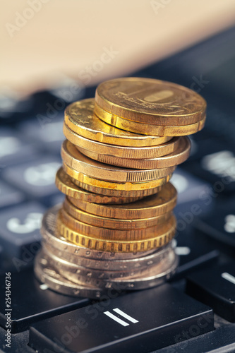 stack of coins and calculator,concept idea for business finance - 254346736
