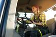 Leinwanddruck Bild - Farmer woman driving a tractor