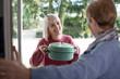 Leinwanddruck Bild - Woman Bringing Meal For Elderly Neighbour