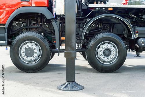 Outrigger car crane. Modern construction equipment - 254390912