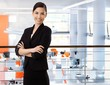Asian businesswoman at office with arms crossed