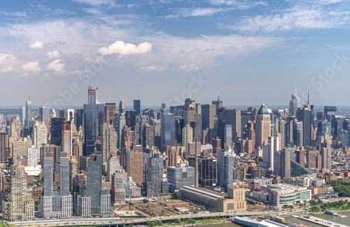 mata magnetyczna Amazing aerial view of New York City. Midtown Manhattan skyline from helicopter on a sunny afternoon