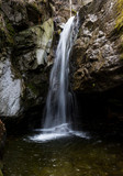 Kostenski Falls - a waterfall in the Rila Mountains, Bulgaria, located along the Old River about three kilometres south of the village Kostenets. The water drops 12 metres. Rocky canyon.
