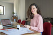Leinwanddruck Bild - Smiling lady interior designer working in home office