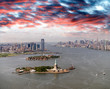Helicopter view of Statue of Liberty with Lower Manhattan and Jersey City in the background, New York City
