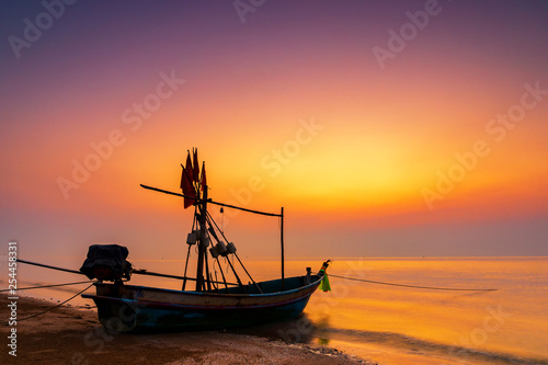 silhouette boat on the sea in the morning during sunrise