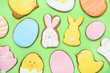 Easter gingerbread cookies on green background