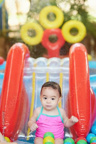 Baby girl in kid pool