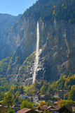 View of Staubbach waterfall and Lauterbrunnen village in the valley in Switzerland.