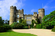 View of the medieval Malahide Castle with green front garden, Dublin County, Ireland - 254517754