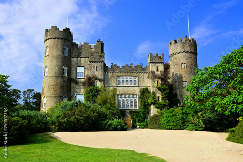 View of the medieval Malahide Castle with green front garden, Dublin County, Ireland