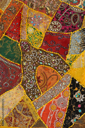 Colorful patchwork carpet with beads.Background,texture. - 254518325