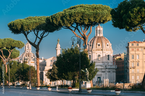 Leinwanddruck Bild Rome, Italy. Via Dei Fori Imperiali Street In Sunny Summer Morning. View On Church Of Most Holy Name Of Mary At Trajan Forum