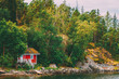 Leinwanddruck Bild - Red Finnish Wooden Bath Sauna Log Cabin On Island In Summer