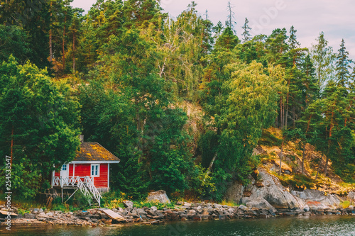Leinwanddruck Bild Red Finnish Wooden Bath Sauna Log Cabin On Island In Summer