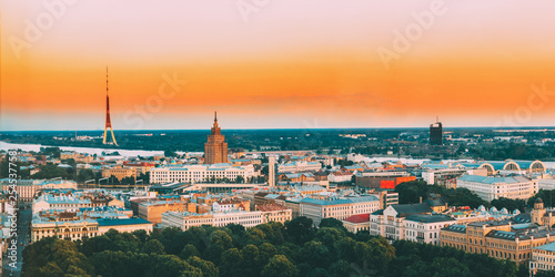 Leinwandbild Motiv Riga, Latvia. Aerial View Panorama Cityscape At Sunset. TV Tower, Academy Of Sciences