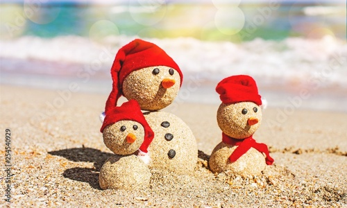 Sandy snowmen. Holiday concept can be used for New Year's and Christmas Cards