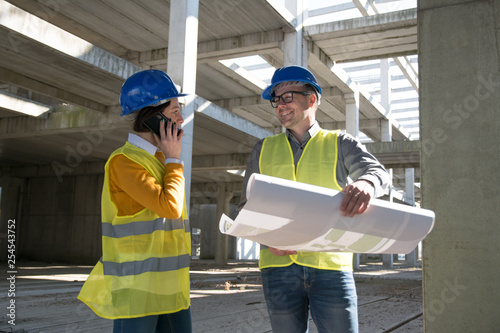 Male architect smiling to his colleague female architect