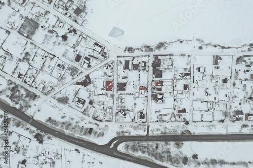 Leinwanddruck Bild Aerial view of village