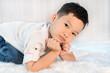 portrait of happy little boy on bed
