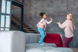 Mother and daughter having much fun while dancing
