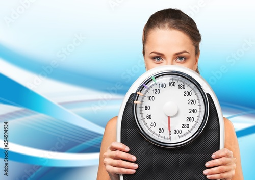 Young woman with scales isolated