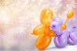 Two balloons in shape of animals on background