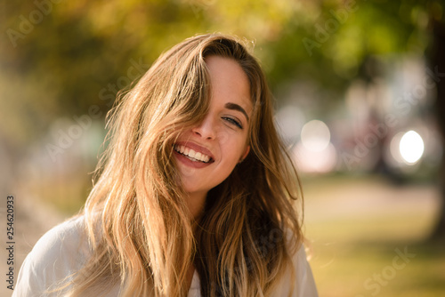Young girl posing stylishly in front of camera