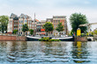 Amsterdam, Netherlands September 5, 2017: Reflection of trees and houses in still water of Amstel river, Amsterdam, Netherlands.