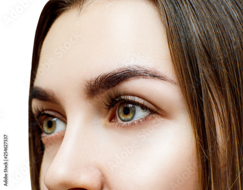 Young woman with extended eyelashes.