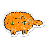 distressed sticker of a cartoon cat