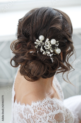 Wedding hairstyle with exquisite decoration from the back. © ksi