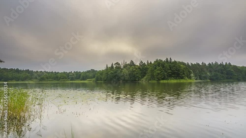 Timelapse of beautiful cloudy morning on a forest lake