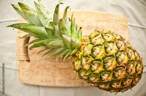 Huge pineapple on cutting board fisheye view - 254641588
