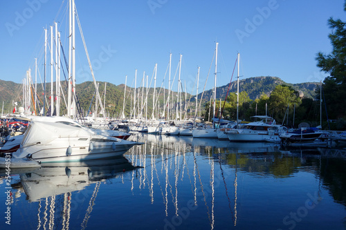 Yachts in the marina. Water reflections.