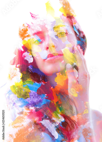 Paintography. Double exposure. Close up of an attractive peaceful model combined with colorful hand drawn acryllic paintings with overlapping brushstroke texture